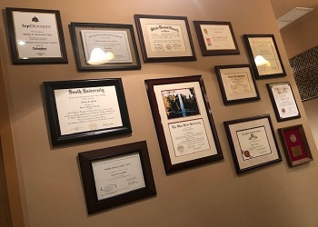 Certificates and degrees on wall