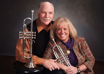 Dr. Shults and her husband with trumpets
